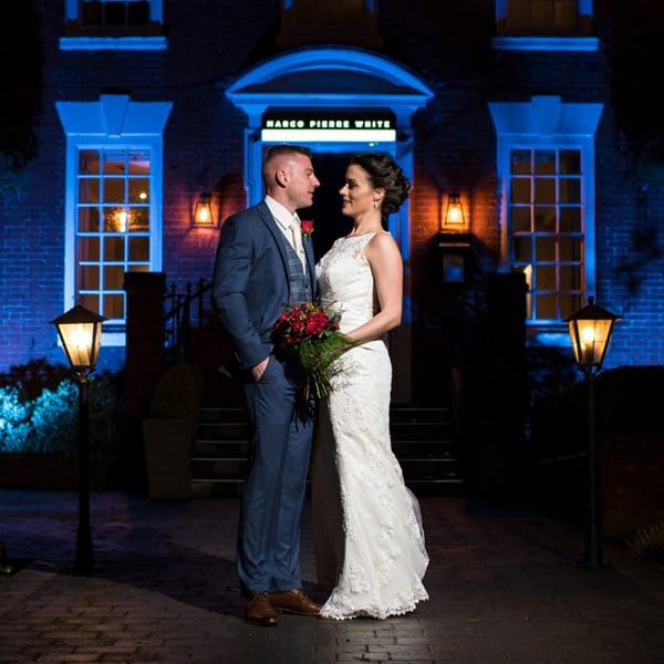 Bride and groom outside venue