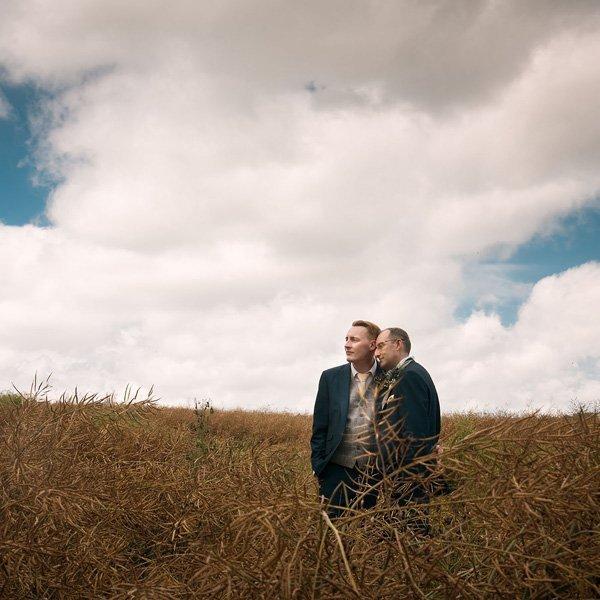 Two men standing in a field