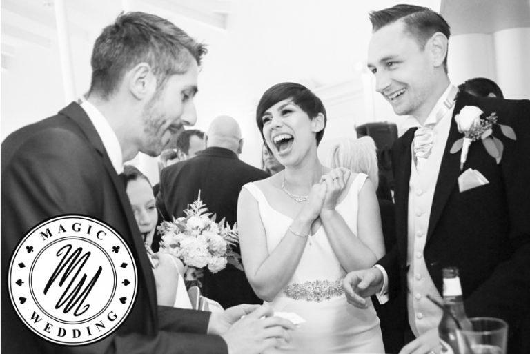 Magician performing magic tricks to wedding guests