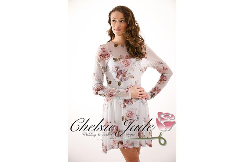 Chelsie Jade Singer posing on a white backdrop