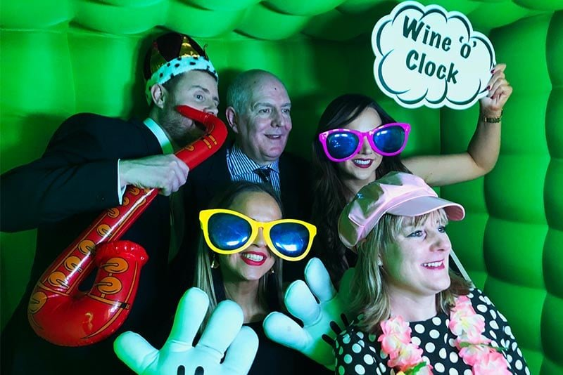 Wedding guests inside a inflatable photobooth
