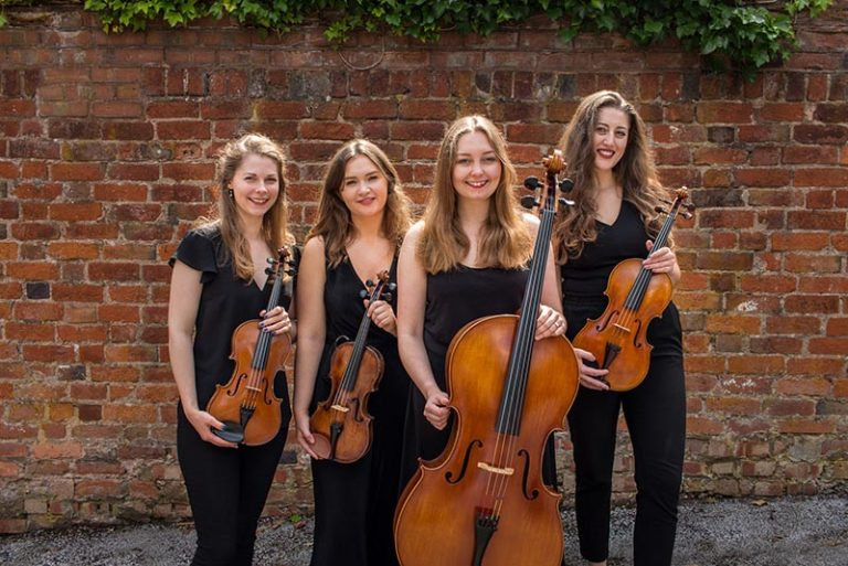 String quartet four ladies with string instruments outside