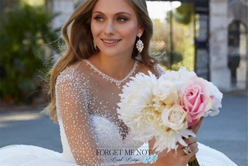 Bride outside holding flower bouquet
