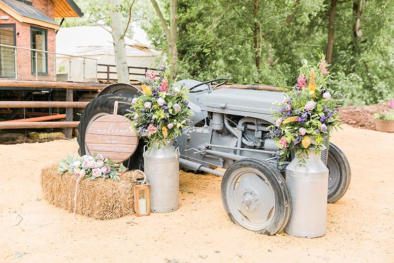 tractor and flowers outside wedding venue